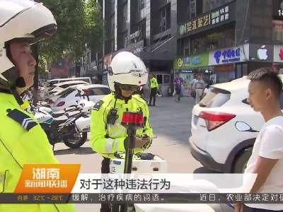 """高温下的坚守:长沙""""铁骑交警""""每天烈日下执勤超五小时"""